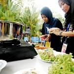 Media representatives busy preparing gulai tempoyak ikan patin and ikan pekasam goreng