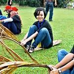Participants playing a traditional Malay games called tarik upih
