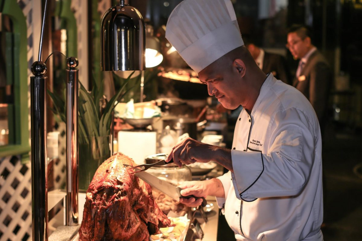 Executive Sous Chef Razali Idris Carving an Oven Roasted Whole Lamb