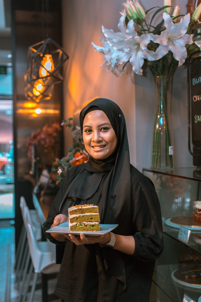 Kayla Yati, the Head Baker at My Own Bakes Cafe, learned most of her tricks from YouTube videos in her early days. (Image © Kamil Azim)