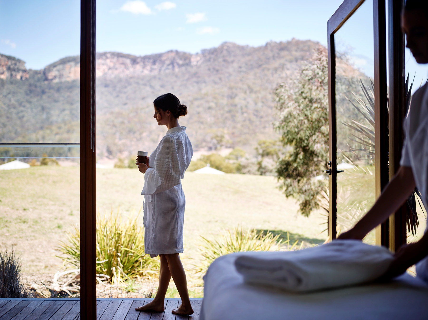 Woman relaxing and enjoying a beverage at Emirates OneandOnly Wolgan Valley spa (Image credit to Emirates OneandOnly Wolgan Valley)